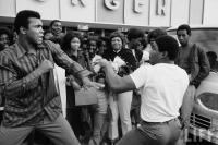 Muhamad Ali sparring playfully w. local man. Photographer: JOHN SHEARER