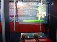 Skozivdiečise ekran™ na Telekomovi stojnici. Si predstavljate vsa okna pri vas doma kot televizorje?